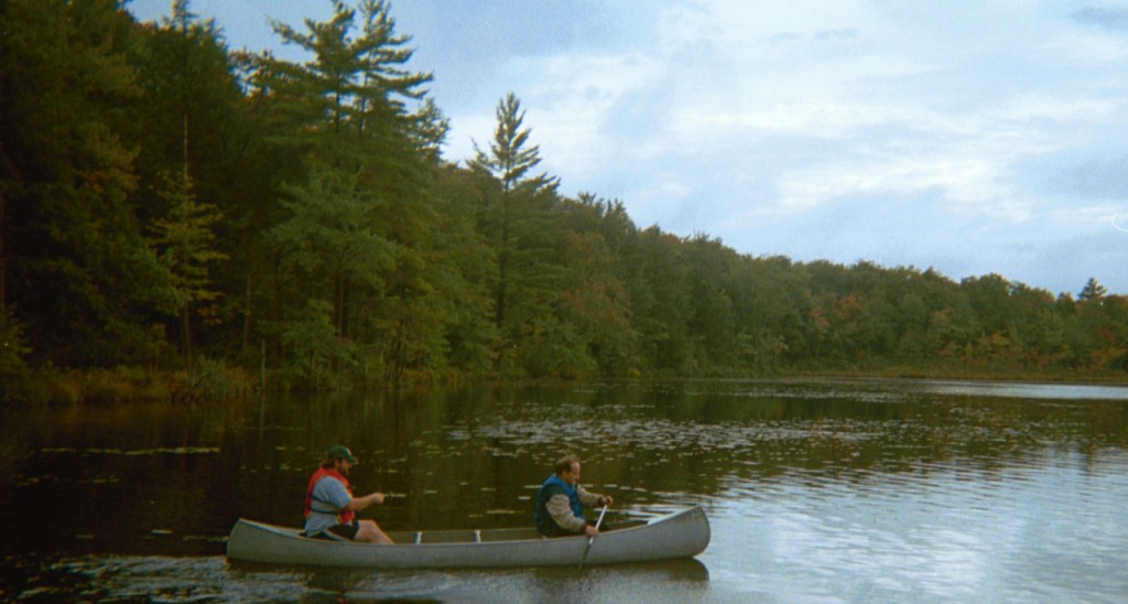 Two people paddling in a canoe