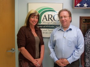 Kay Miracle-Burke, Business Manager of Americar and Mike Szpak, ED of ARC of Oswego County