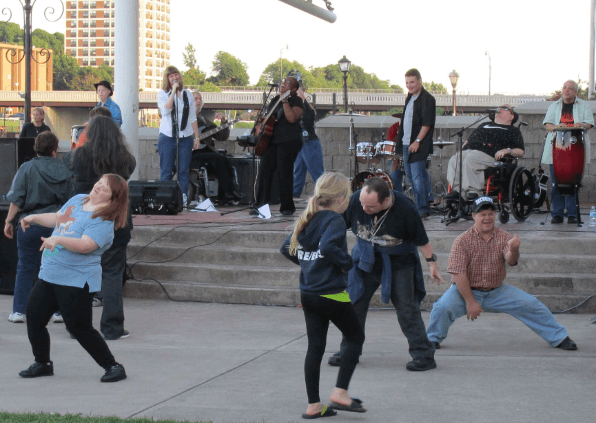 Individuals enjoying music by Flame the band