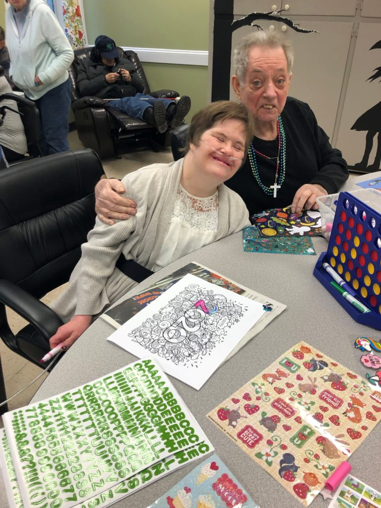 Two friends with disabilities hugging